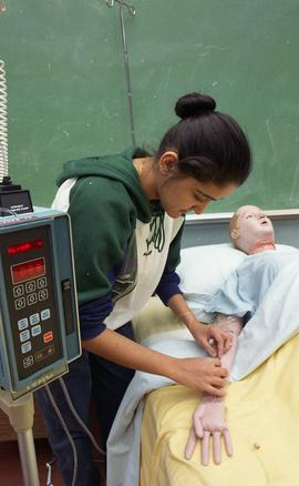 General Nursing, student with dummy patient in bed [1 of 8 photographs]