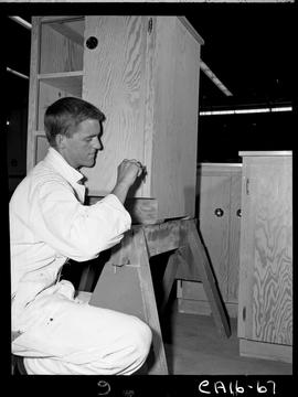 B.C. Vocational School image of a Carpentry Trades student inside the Carpentry shop attaching a ...