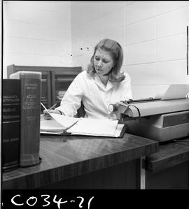 BC Vocational School Commercial Program; women sitting in an office at a desk with a typewriter w...