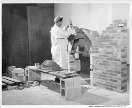 Bricklaying; A student building a brick fireplace; Photo by the Division of Vocational Curriculum...