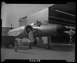 BC Vocational School image of an Aeronautics instructor and students working on an aircraft in Bu...