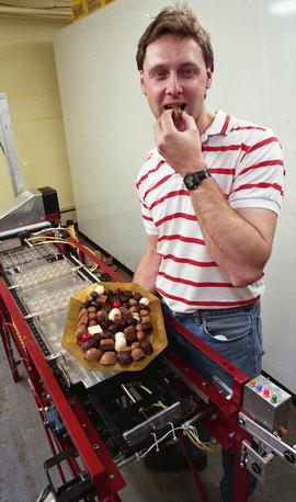 Gordon Thiessen, Chocolate Factory for Technology Centre, man posing with machine, chocolates [3 ...