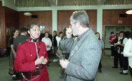 BCIT open house '98, staff member talking with a woman in a RCMP uniform