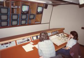 Broadcast Communication, 1983; two people working in a television control booth