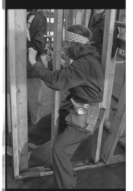 Woman hammering, PVI Maple Ridge 1981; WEAT; Women