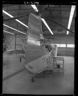 British Columbia Vocational School image of an Aeronautics student and Navy 621 helicopter inside...