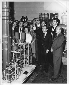 Forest Products, 1967; a group of people looking at a model of a forest products plant