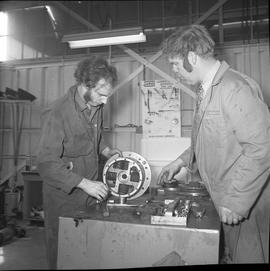 BCVS Heavy duty mechanic program ; a student and an instructor looking at parts of a motor
