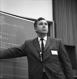CVA Convention, 1969 ; man standing in front of a chalkboard
