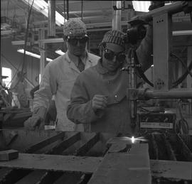 Welding, Terrace, 1968; two men wearing protective googles, one of the men using welding equipmen...