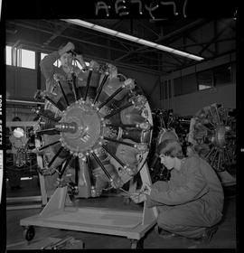 BC Vocational School; Aeronautics students working on an aircraft engine inside the hangar in Bur...