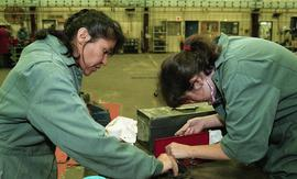 BCIT women in trades; heavy duty, students in uniforms using mechanical tools and equipment [4 of...
