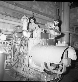 BC Vocational School Diesel Mechanic program ; two students repairing a large diesel engine [2 of 3]