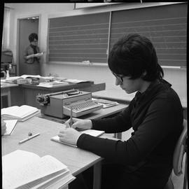 BC Vocational School Commercial Program; student using shorthand to record information in a steno...