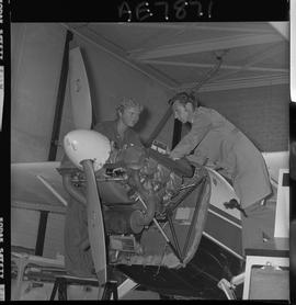 BC Vocational School; Aeronautics student and instructor working on a small propeller aircraft en...