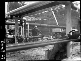 B.C. Vocational School image of some of the piping and workman near the construction of a large s...