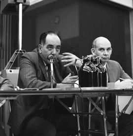 CVA Convention, 1969 ; man sitting at a table with a microphone