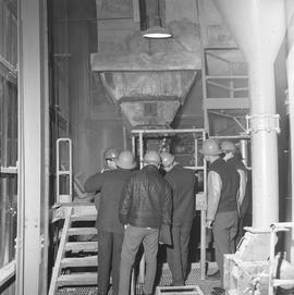 Forestry, Wood fiber BCIT tour, November 26, 1965; men wearing hard hats looking at machinery