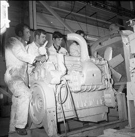 BCVS Heavy duty mechanic program ; group of students looking at a large engine and exhaust