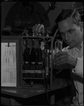 Mechanical technology, 1967; man in a lab coat using a testing device [1 of 2]
