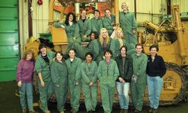 BCIT women in trades; heavy duty, students in uniforms standing in front of a bulldozer [9 of 9 p...