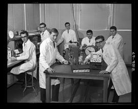 Men in BCIT lab coats with equipment [v2 - fading corrected by digitizer]