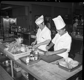 BC Vocational School Cook Training Course ; two students cutting fruit [1 of 2]