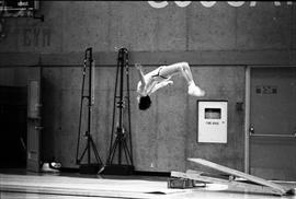 BCIT image of a man doing a back flip in the BCIT Gymnasium.