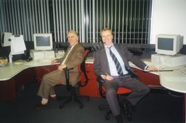 Alumni phone-a-thon, April 1999; Keith Carrington(?) and Peter Broerken sitting at desks answerin...