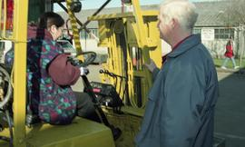 BCIT women in trades; forklift training, instructor beside a student driving a forklift [8 of 8 p...