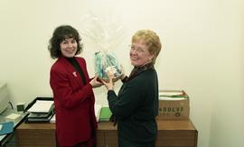 Two female staff members holding a gift basket [5 of 5 photographs]