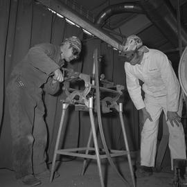 Welding, Dawson Creek, 1968; instructor watching a student using welding equipment