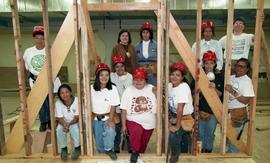 Pre-trade Aboriginal women; carpentry, students and instructor in carpentry class wearing hard ha...