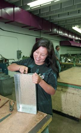 Pre-trade Aboriginal women; sheet metal, students using materials and equipment in class [6 of 11...