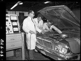 B.C. Vocational School image of an Automotive program instructor teaching and students observing ...