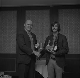 Hockey presentation, Plaza 500, 1972; player receiving a trophy [2 of 2]