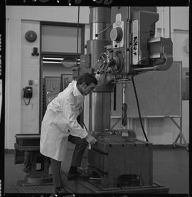 Mechanical technology, 1968; man in a lab coat using a large drill [1 of 2]