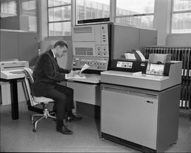 Business Management program, man seated, working with IBM 2501