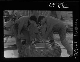 Tire Repair Program; two men with tire
