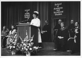 Convocation, January 1987; woman from the Nursing program speaking at a podium; Brian Gillespie s...