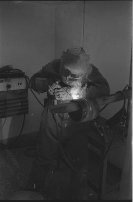 Pacific Vocational Institution ; a welding student working