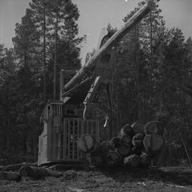 Logging Loading, Nanaimo, 1968; a log lifter and a large pile of logs