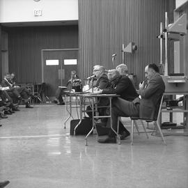 CVA Convention, 1969 ; men sitting at a table with microphones ; one man smoking a pipe