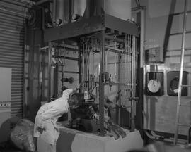 Forest Products, 1966; a man in lab coat using Sumner forest product equipment [1 of 3]