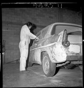 BC Vocational School image of Autobody program student working on a vehicle in the shop [3 of 5 p...