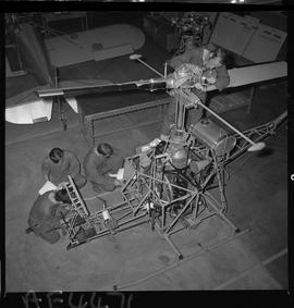 BC Vocational School; Aeronautics students working on a helicopter in the hangar in Burnaby [2 of...