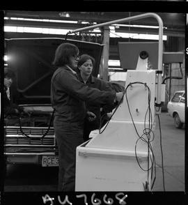 B.C. Vocational School image of students in the Automotive Mechanics program working on a vehicle...