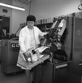 BCVS Graphic arts ; woman using a paper collator