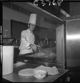 BC Vocational School Cook Training Course ; student frying food [1 of 2]