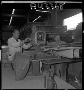 B.C. Vocational School image of an Instructor and Auto Mechanics program student working on autom...